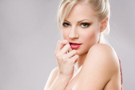 shy woman: Closeup portrait of a sensual young blond woman.