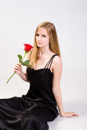 Portrait of an Attractive young blond with fresh rose. photo