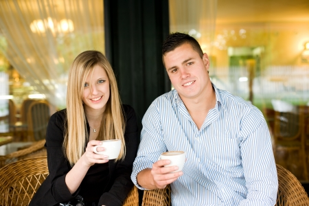 Portrait of a happy cute young couple having coffee. photo