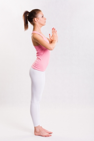 white pants: Attractive flexible young yoga fitness girl doing exercises.