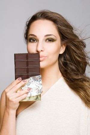 Portrait of a sensual happy brunette chocolate girl. photo