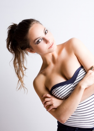 cleavage: Portrait of a gorgeous young relaxed happy brunette woman. Stock Photo