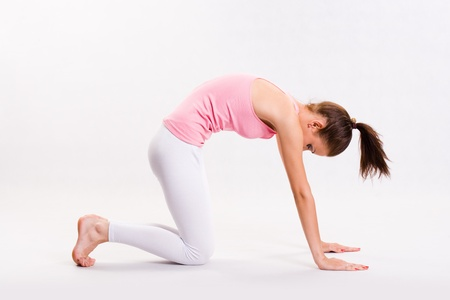 yoga pants: Portrait of a flexible young yoga girl in pink top.