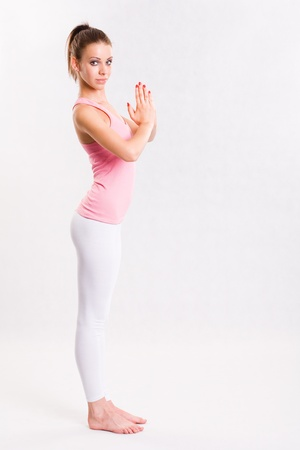 Portrait of a flexible young yoga girl in pink top. photo