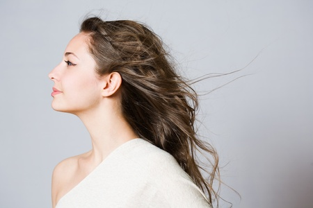 side profile: Portrait of a fashionable dreamy young brunette beauty.