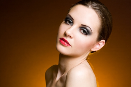 decadent: Portrait of decadent looking brunette beauty in heavy makeup. Stock Photo