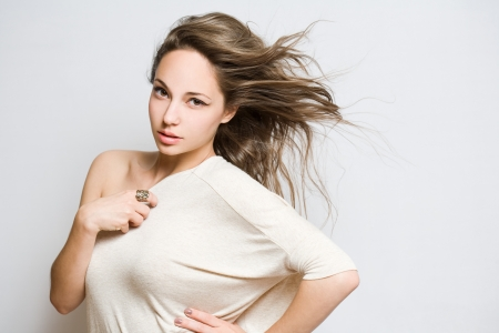 asian model: Portrait of a fashionable young brunette beauty in white top. Stock Photo
