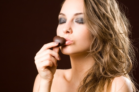 Portrait of a chocolate loving young brunette beauty Stock Photo - 14401855