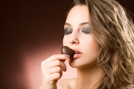 Portrait of a sensual brunette chocolate girl. photo