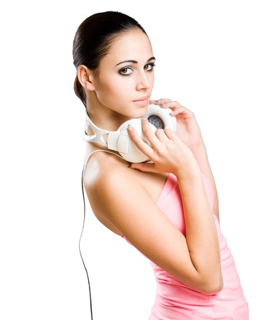 Half length portrait of a beautiful young brunette woman with white headphones. photo