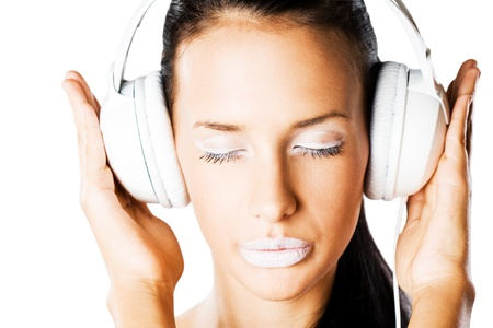 sexy headphones: Bright wibe, portrait of gorgeous young brunette woman in creative makeup listening to music in white headphones.
