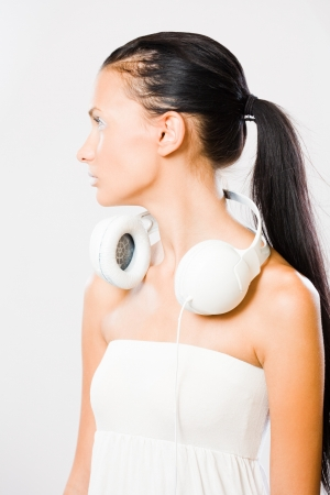Bright wibe, portrait of gorgeous young brunette woman in creative makeup listening to music in white headphones. photo