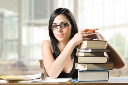 Portrait of a beautiful young brunette student woman. Stock Photo - 14838394