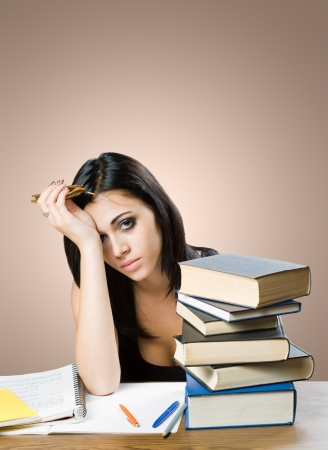 Wasted, portrait of an exhausted young student with pile of books. Stock Photo - 14838436