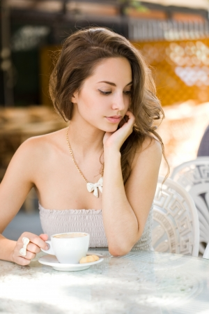 Portrait of a romantic beautiful brunette coffee girl. photo