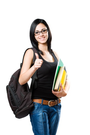 Portrait of a beautiful young student girl showing thumbs up isolated on white background