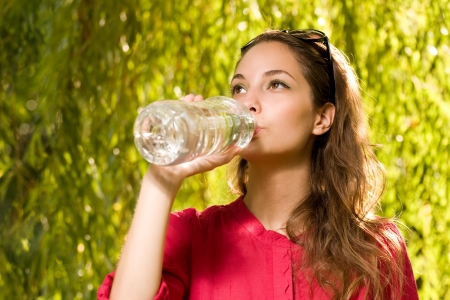 Portrait of a young brunette with cool refreshment  photo