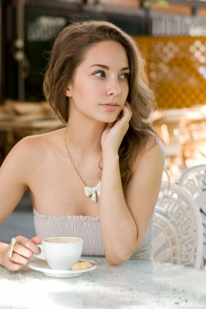 Portrait of a brunette beauty enjoying her coffee. photo