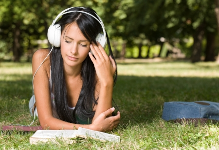 slender woman: Portrait of a young student girl relaxing, studying outdoors in the park. Stock Photo