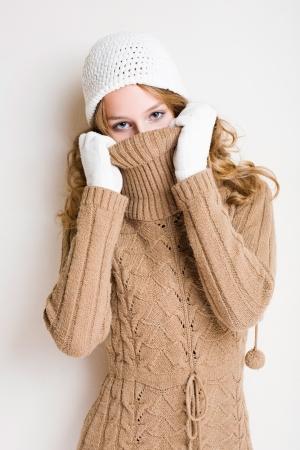 peek a boo: Portrait of young slender winter fashion model.