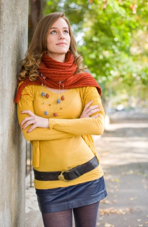 woman sweater: Colorful harmony for autumn fasion, portrait of a fashionable friendly young blond woman outdoors.