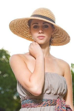Half length portrait of an elegant young summer brunette woman.