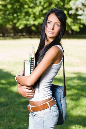 Outdoors portrait of a gorgeous young brunette student. Stock Photo - 15005467