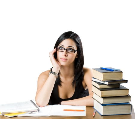 Portrait of a pensive young student girl among many books. Stock Photo - 15119219