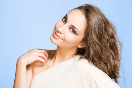Closeup portrait of a cheerful young brunette beauty. Stock Photo - 15118583