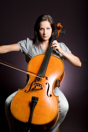 cellist: Passionate real artist, young woman playing her classical instrument.