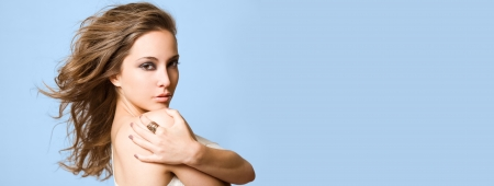 flowing hair: Wide long banner with beauty shot of a gorgeous young brunette woman in makeup.