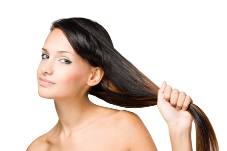 pulling hair: Closeup portrait of a brunette beauty with shiny healthy hair.