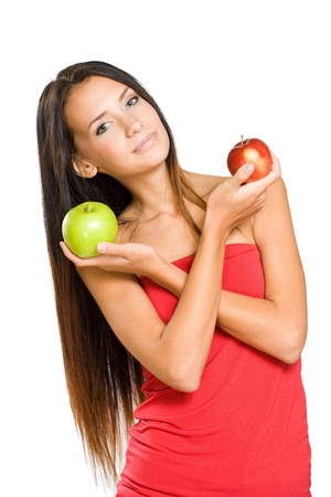 Portrait of an attractive young brunette woman with juicy apple. photo