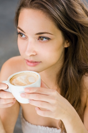 sideways glance: Coffee romance, portrait of a gorgeous young brunette woman.
