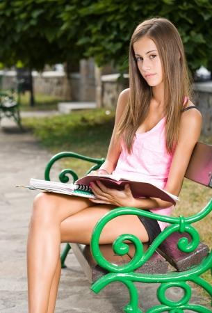 skinny girl: Outdoors portrait of a beautiful tanned teen student girl.
