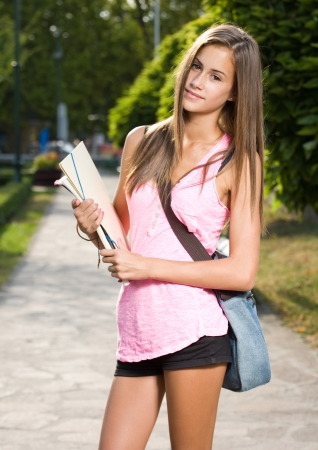 tanned girl: Back to school, portrait of a beautiful friendly teen student girl.