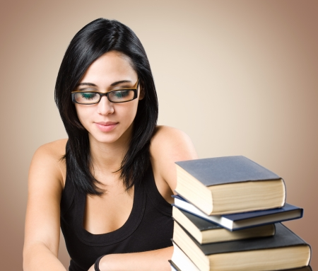 Portrait of a gorgeous young brunette student woman. Stock Photo - 15718848