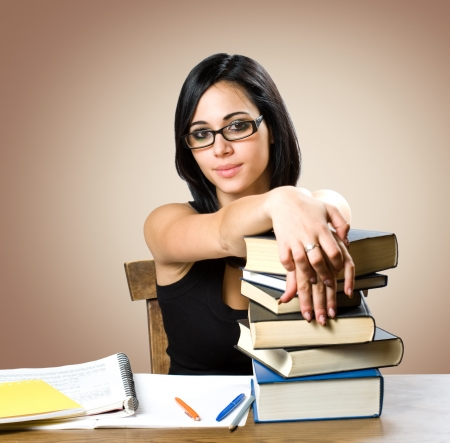 Portrait of a gorgeous young brunette student woman. Stock Photo - 15718837