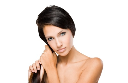 pulling hair: The hair check, portrait of a beautiful young brunette woman with shiny hair.