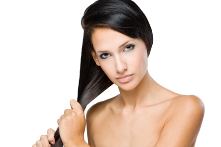 pulling hair: Portrait of a brunette beauty with strong healthy shiny hair.