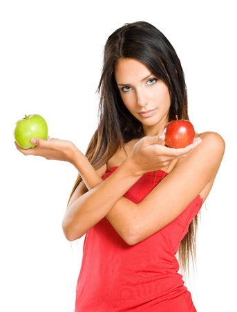 Portrait of a young brunette holding two colorful apples. photo