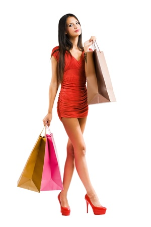 Fashionable young woman with shopping bags. photo