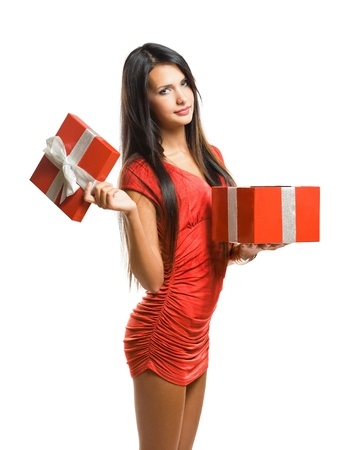 colorful dress: Gorgeous young woman with shiny red christmas gift box isolated on white background. Stock Photo