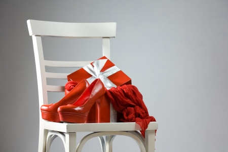 Red hot christmas package with hig heel shoes and scarf. photo