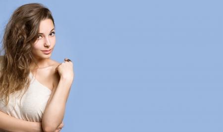 flowing hair: Portrait of gorgeous brunette woman on a large long blue banner.
