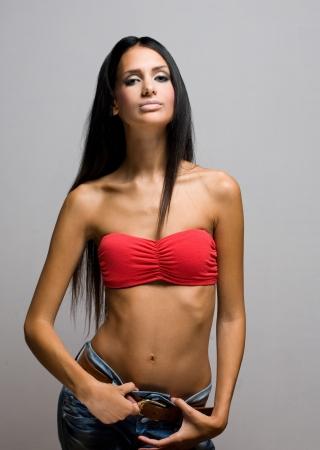 latin girls: Half figure portrait of a beautiful skinny brunette.