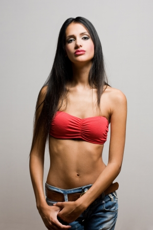 Half figure portrait of a beautiful skinny brunette. photo