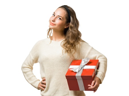Cheerful friendly young brunette with red gift box isolated on white background. photo