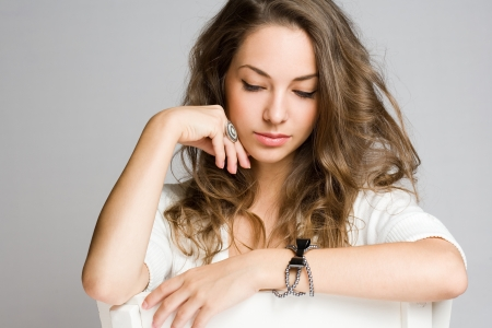 sitting down: Expressive portrait of beautiful young brunette woman.