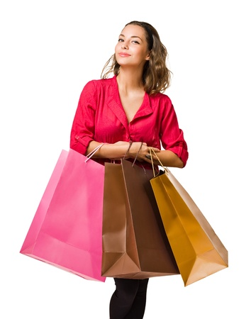asian girl shopping: Cool friendly young brunette woman holding colorful shopping bags